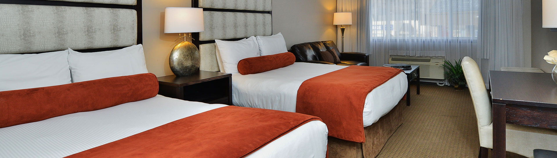 Hotel room with 2 beds and a desk - Photo Credit Prestige Hotel